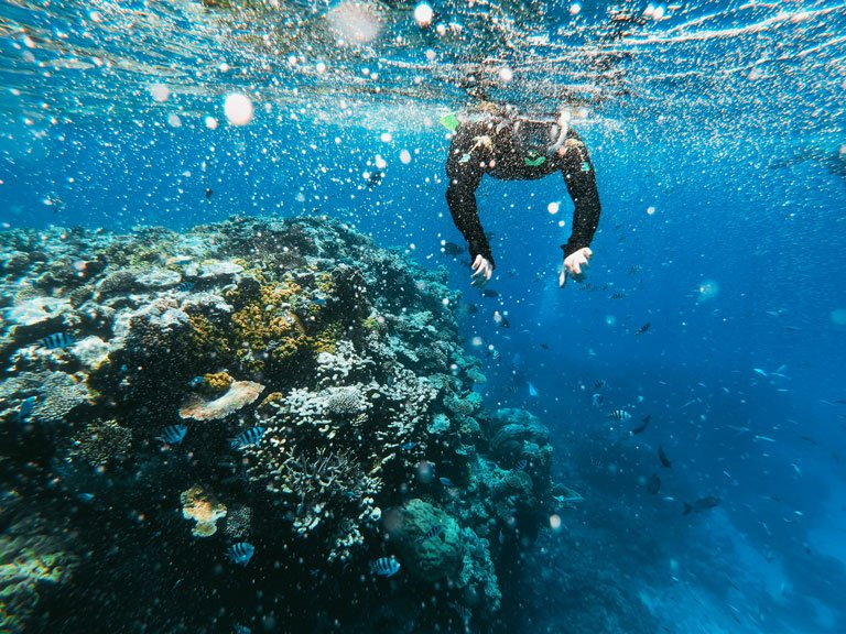 A person doing snorkelling at Amed beach in Bali