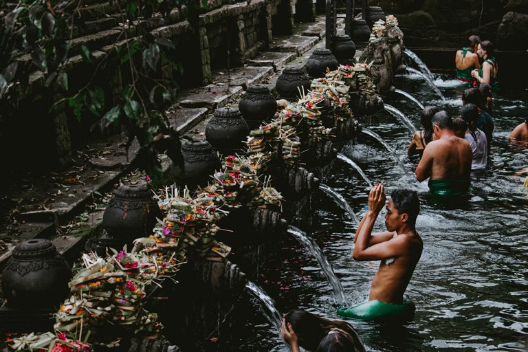 Many people purifying themselves during the Melasti in Tirta Empul, Bali