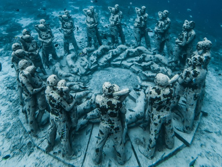 Underwater statues on the island of Gili Meno