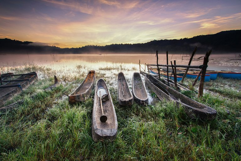 Boats on the shores of Tamblingan Lake, Bali