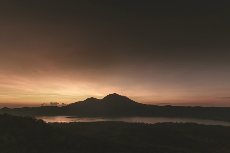 Beautiful sunrise with views of the lake and Mount Batur, Bali