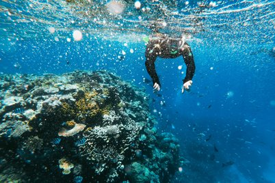 A person is snorkelling in Padangbai, Bali