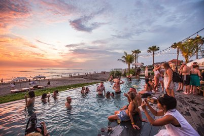 Sunset from the infinity pool of one of the beach clubs in Canggu, Bali